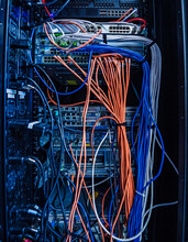 Bundles Of Colorful Cables Plugged Into Server Rack