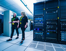 Two Co-workers Walking Together In Data Center