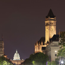 USA, Washington DC, Tower Of Old Post Office At Night With United States Capitol In Background