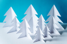 Paper Forest With White Trees On Table Against Blue Background