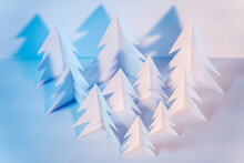 Paper Forest With Handmade White Christmas Trees Arranged On Table In Studio