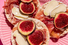 Rice Cakes With Serrano Ham, Cheese And Fig Slices