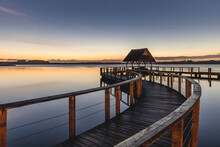 Germany, Schleswig-Holstein, Hemmelsdorf, Empty Pier On Shore Of Hemmelsdorfer See Lake At Dawn