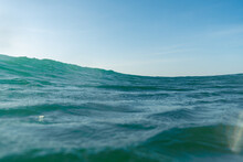 Breaking Waves And Spray, White Water And Light Reflected On The Surface Of The Water