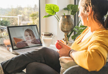 Woman Talking With Little Girl During Video Call On Laptop
