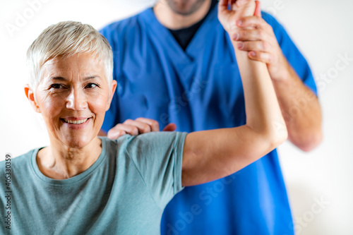 Canvas Print Midsection Of Male Chiropractor Doing Chiropractic Adjustment Of Female Patient