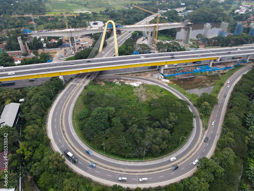 Aerial drone view of highway multilevel junction road with moving cars and noise cloud Fotobehang
