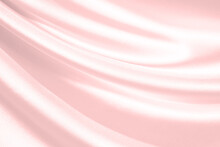 Pink Silk Satin Background. Soft Wavy Folds On The Fabric. Wedding, Anniversary, Valentine, Love, Tender, Holiday, Celebration, Card. Beautiful Pink Abstract Background With Copy Space For Your Design