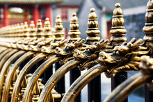 The Golden Dragon Head Is Carved, And The Background Of The Ancient Architecture Is Blurred.