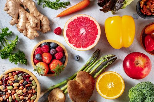 Fototapeta Vegan food, overhead flat lay shot. Grapefruit, asparagus, and other superfoods, healthy organic ingredients obraz