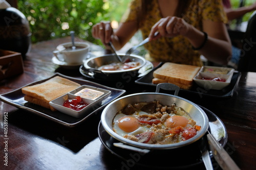 Fotografie, Obraz Midsection Of Woman Having Food In Restaurant