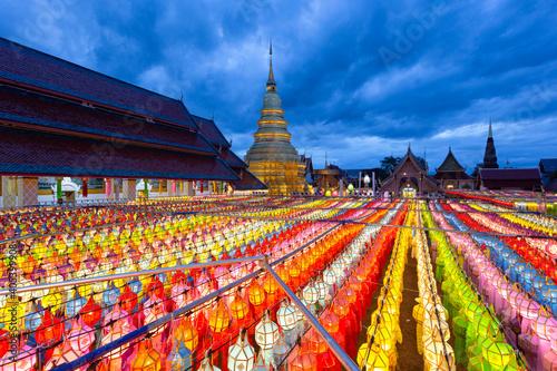 Fotografie, Obraz Colorful Lamp Festival and Lantern in Loi Krathong at Wat Phra That Hariphunchai