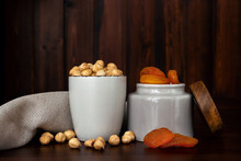 Bowls With Brazilian Nuts And Dried Apricots On Wooden Table. Dried Fruits And Nuts Concept