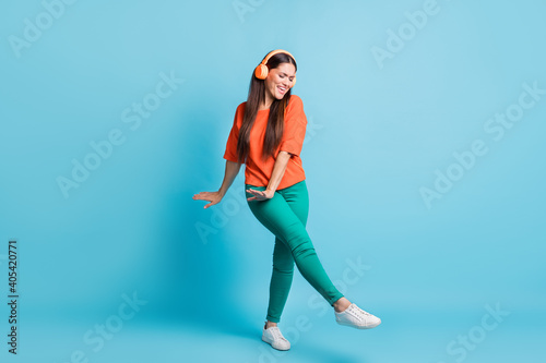 Full body photo of crazy charming lady dancing listen to single closed eyes isolated on blue color background