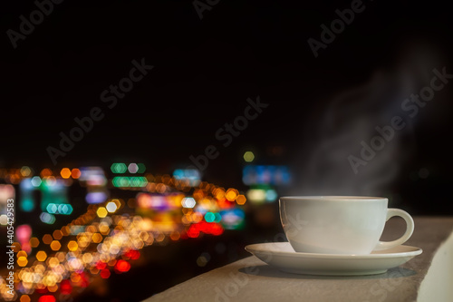 White Coffee Cup With Soft Stream Smoke And High Angle View Of City Scape фототапет