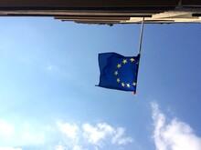 Upside Down Image Of Flag Against Sky
