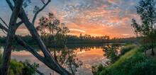 Beautiful Panoramic Riverside Sunrise With Cloud Reflections