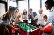 Leinwandbild Motiv Colleagues playing table football in the break.