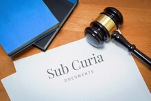 Sub Curia. Document With Label. Desk With Books And Judges Gavel In A Lawyer's Office.