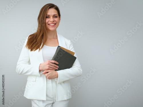 Fotografie, Tablou Woman teacher in white business suit holding books.