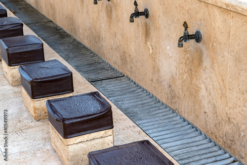 Obraz na plátne Close up of benches for ritual ablution in the mosque