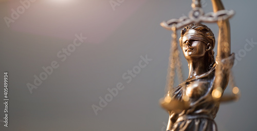 Fototapeta Close-up Of Lady Justice Statue Against Black Background