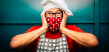 Shock And Crazy Expression Scared Man With Chef Hat And Red Medical Protection Mask - Coronavirus Covid-19 Economy Restrictions Image Concept With People At Work During Lockdown And Background