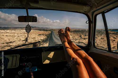 Obraz na plátně Travel and freedom concept people with close up of woman legs enjoy the road tri
