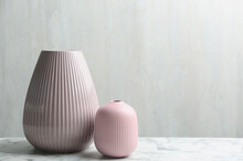 Stylish Pink Ceramic Vases On White Marble Table, Space For Text