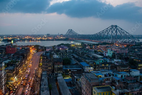 Obraz High Angle View Of Illuminated City Buildings At Night - fototapety do salonu