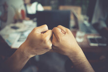 Cropped Image Of Colleagues Giving Fist Bump