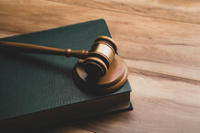 Wooden Judge Gavel And Legal Book