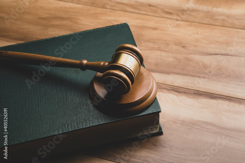 Canvas Print Wooden judge gavel and legal book