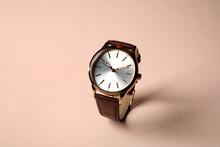 Luxury Wrist Watch On Pale Pink Background. Fashion Accessory