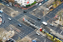 A City Crossing With Tram And Cars Seen From Above.