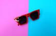 Leinwandbild Motiv Directly Above Of Sunglasses Over Colored Background