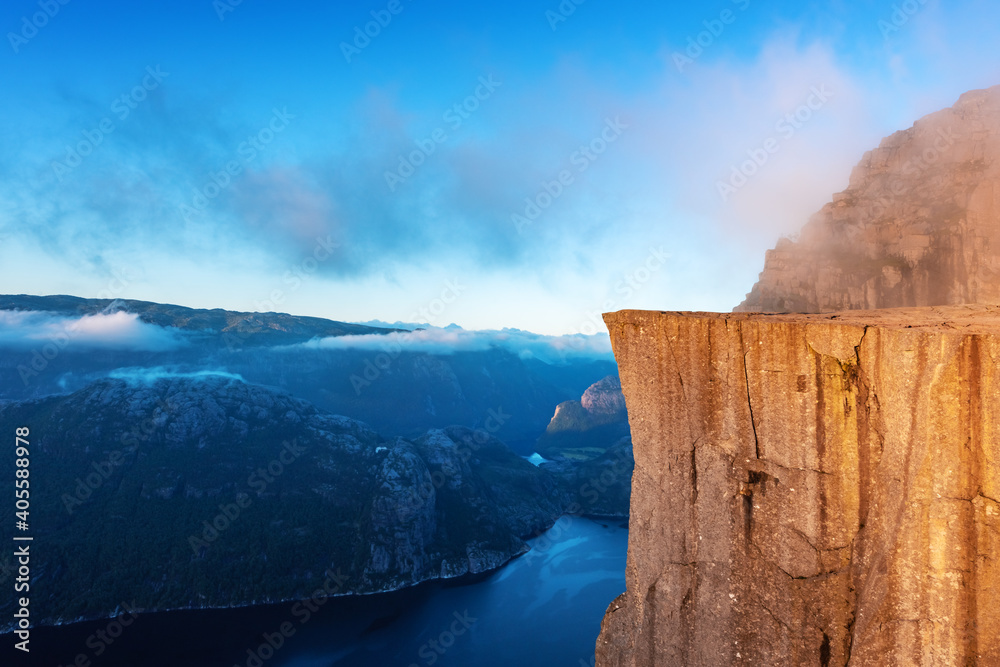Fototapeta Misty morning on Preikestolen (pulpit-rock) - famous tourist attraction in the municipality of Forsand in Rogaland county, Norway. Landscape photography