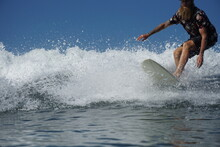 Low Section Of Man Surfing In Sea