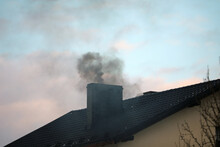 Dark Smoke From A Chimney From A Single-family House