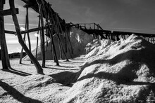 Dramatic Black And White Image Of Old Salt Mine Still In Use On The Caribbean Shore In Dominican Republic.