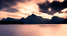 Long Exposure Of Grand Teton Range Viewed From Colter Bay Across Lake Jackson, In Grand Teton National Park, Wyoming: Grand Teton On The Left, Mount Moran In The Middle And Bivouac Peak On The Right.