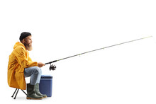 Profile Shot Of A Bearded Fisherman Catching With A Fishing Pole Seated On A Chair