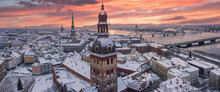 Riga Old Town Cityscape Top Winter View. Famous Aerial Sight And Toursist Destination Of Domes Cathedral. Travelling To Latvia