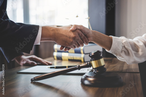 Close-up Of Lawyer And Customer Shaking Hands On Table Poster Mural XXL