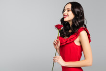 Smiling Young Woman Holding Red Rose Isolated On Grey
