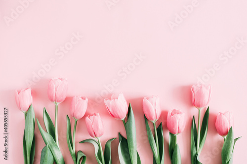 Obraz Beautiful composition spring flowers. Bouquet of pink tulips flowers on pastel pink background. Valentine's Day, Easter, Birthday, Happy Women's Day, Mother's Day. Flat lay, top view, copy space - fototapety do salonu