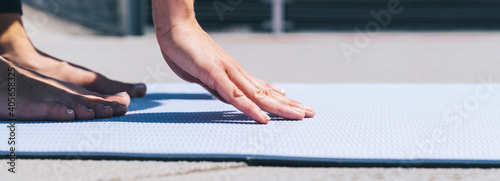 Low Section Of Woman Exercising On Mat