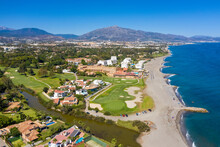 Aerial View Of Golf Course On Coast, Atalaya Isdabe, Malaga, Spain