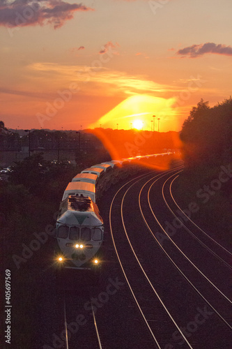 Fototapeta premium High Angle View Of Railroad Tracks Against Sky During Sunset
