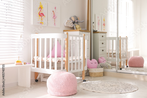 Baby room interior with beautiful pictures on wall